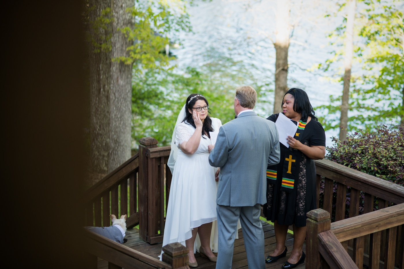 bride cries during waterfront ceremony