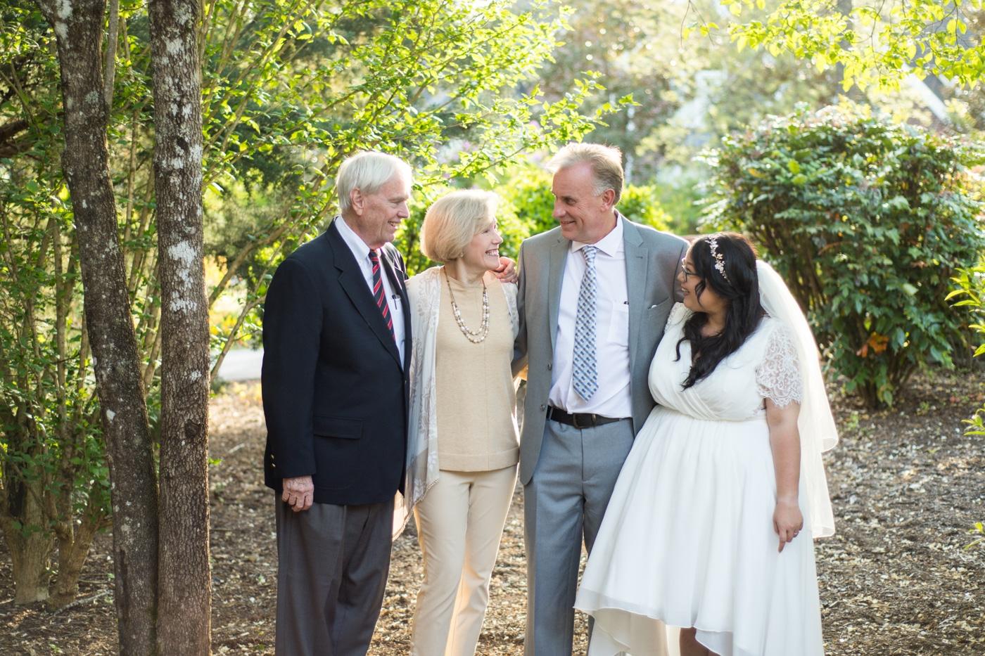groom hugs parents and wife at Lake Blue Ridge