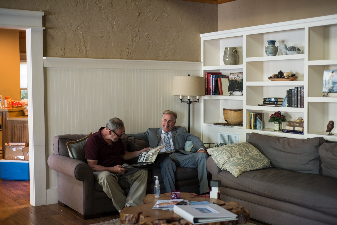 guest sits and talks with groom at lake house