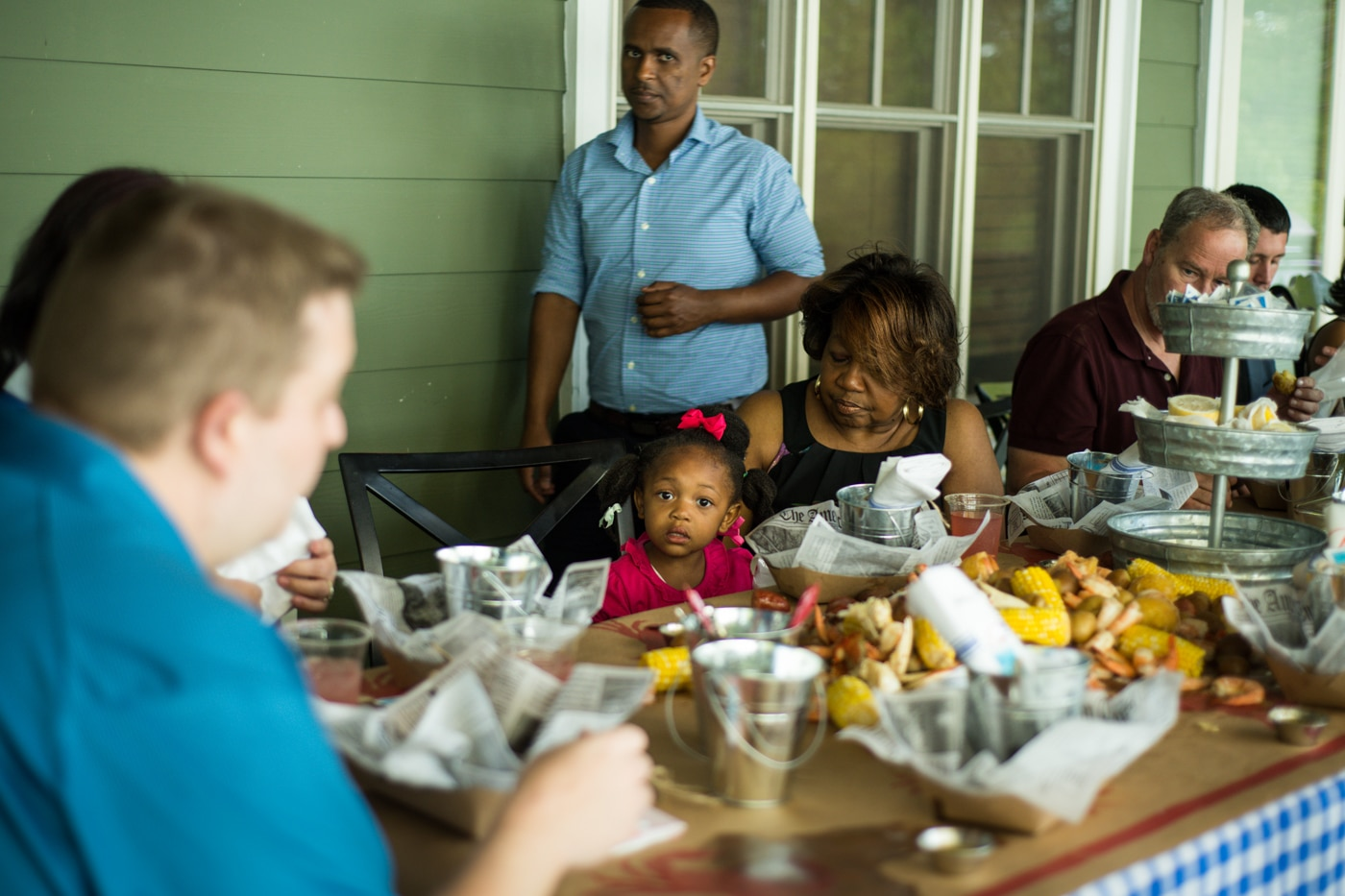 family and friends eat during wedding reception