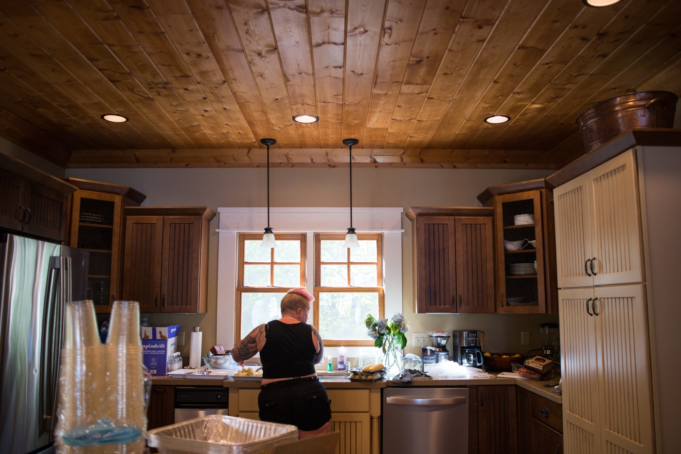 woman prepares food in kitchen for wedding day