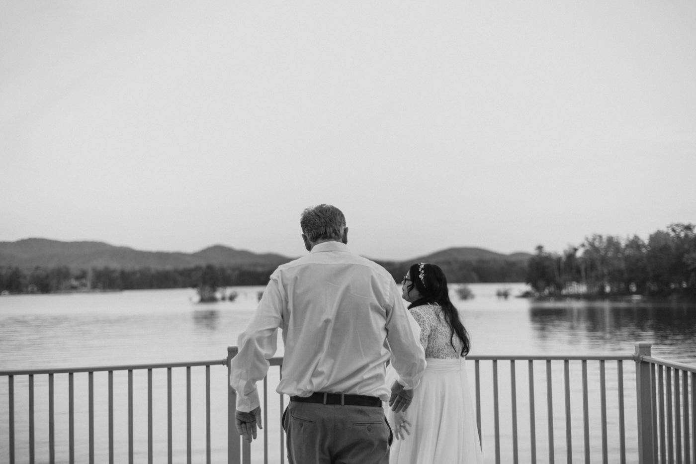 bride and groom walk to see Lake Blue Ridge