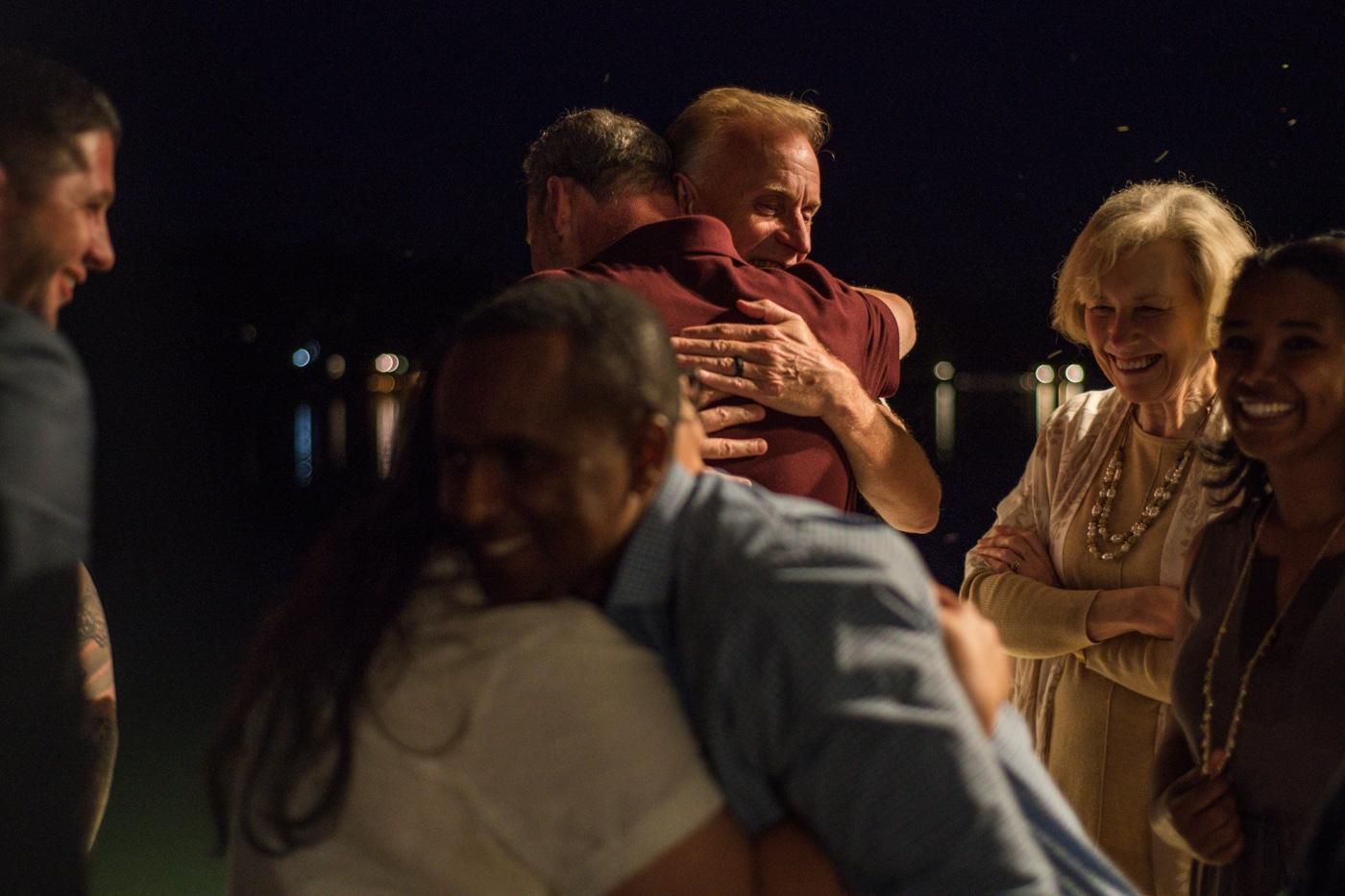 couple hugs during memorial lantern release