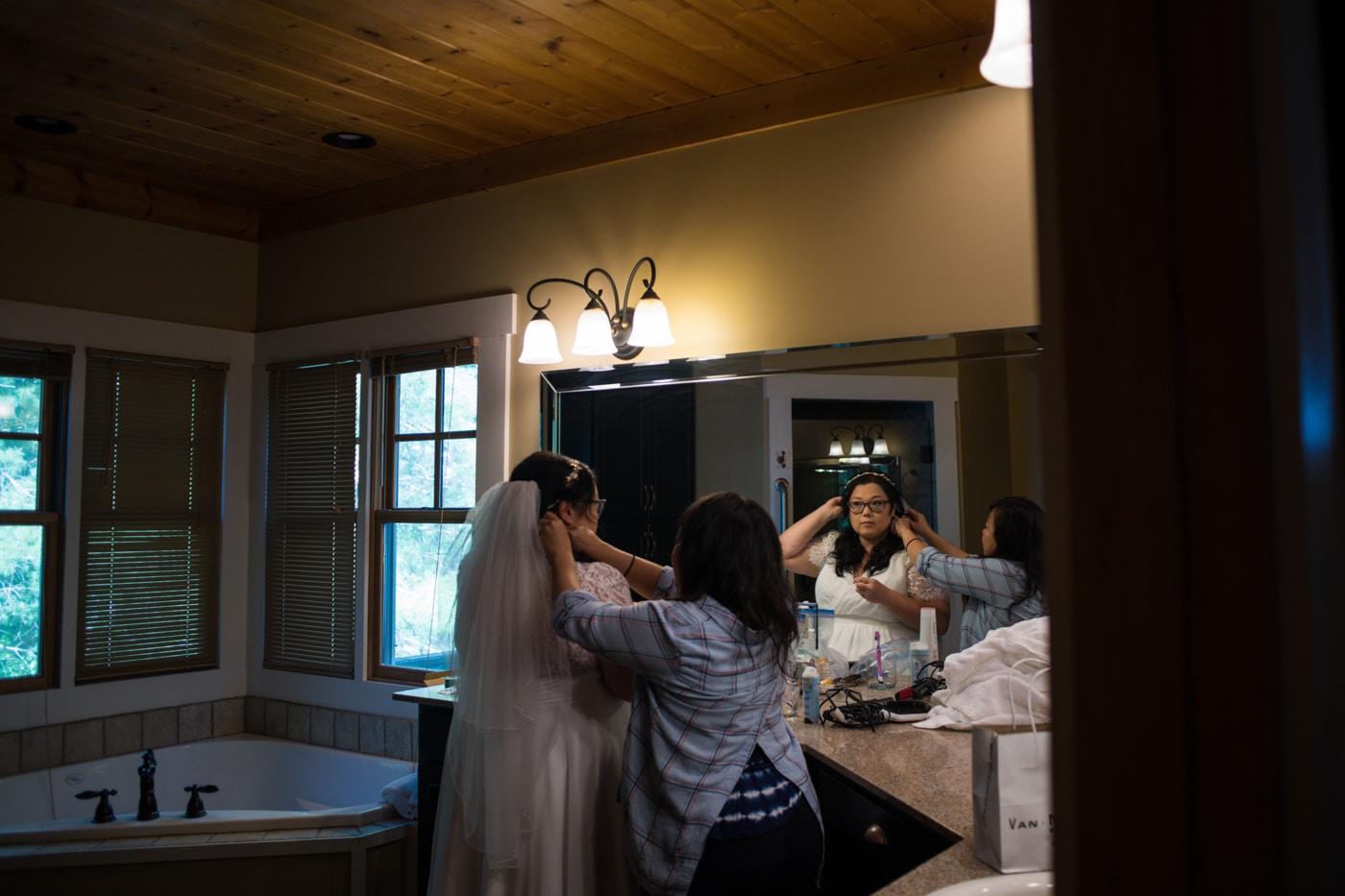mom helps bride with veil before Lake Blue Ridge wedding ceremony