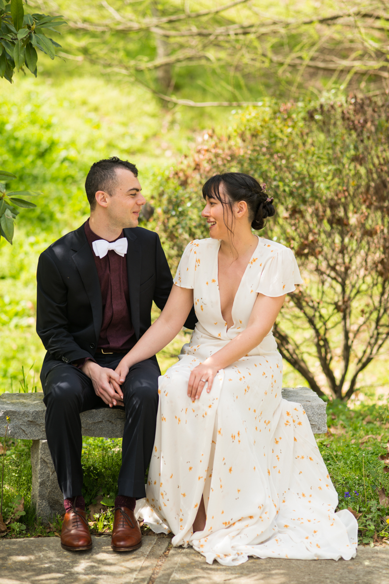 couple sits together talking on wedding day in Atlanta